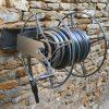 enrouleur pivotant original pour tuyau d'arrosage
